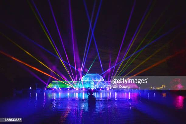 The Palm House at Kew Gardens is illuminated with a light show during a preview for the Christmas at Kew event on November 19, 2019 in London,...