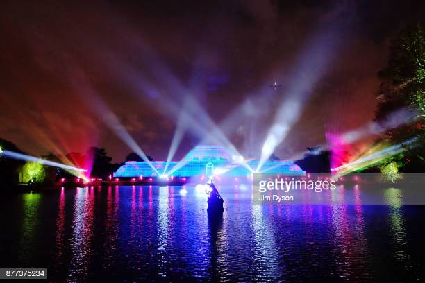 The Palm House at Kew Gardens is illuminated with a light show during a preview for the Christmas at Kew event on November 21 2017 in London England...