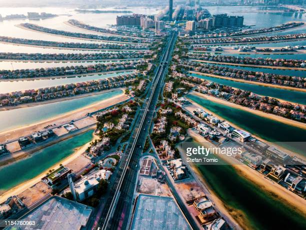 the palm island in dubai aerial view - gulf countries stock pictures, royalty-free photos & images