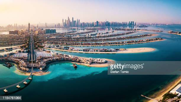 the palm island panorama with dubai marina in the background aerial - middle east stock pictures, royalty-free photos & images