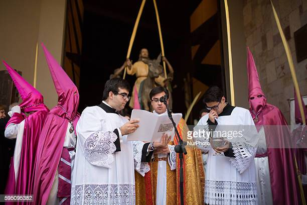 The palms of the penitents are blessed before the procession that commemorates the triumphal entry of Jesus into Jerusalem riding on a donkey in...