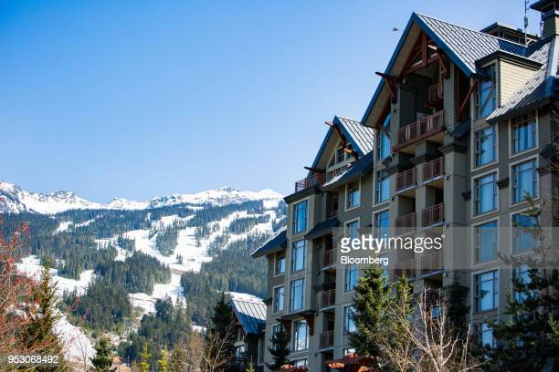 The Pan Pacific Whistler Village Centre hotel stands in front of Vail Resorts Inc Whistler Blackcomb ski mountain in Whistler British Columbia Canada...