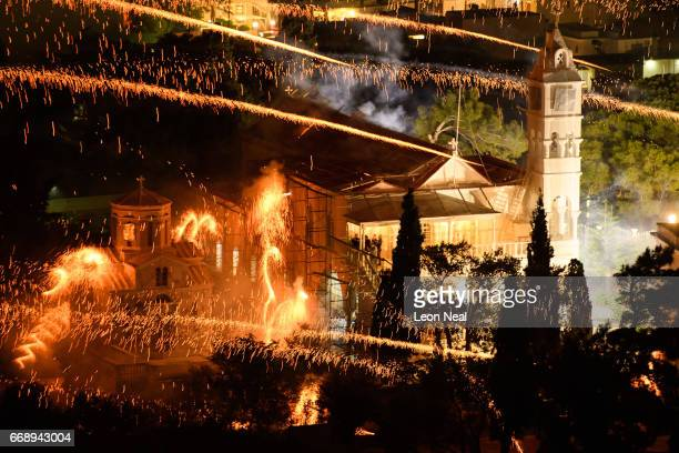 The Panaghia Erithiani Church is hit by rockets from supporters of the Aghios Marko Church during the annual Rocket War, known locally as the...