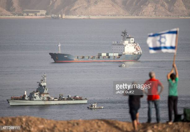 The Panamanian-flagged Klos-C is escorted into the southern Israeli port of Eilat by two Israeli warships on March 8, 2014 after it was intercepted...