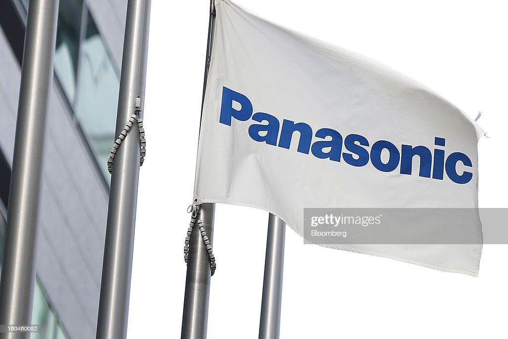 The Panasonic Corp. corporate flag flies outside the company's building in Tokyo, Japan, on Friday, Feb. 1, 2013. Panasonic, Japan's second-biggest television maker, reported an unexpected third-quarter profit because of a weaker yen and restructuring efforts. Photographer: Kiyoshi Ota/Bloomberg via Getty Images