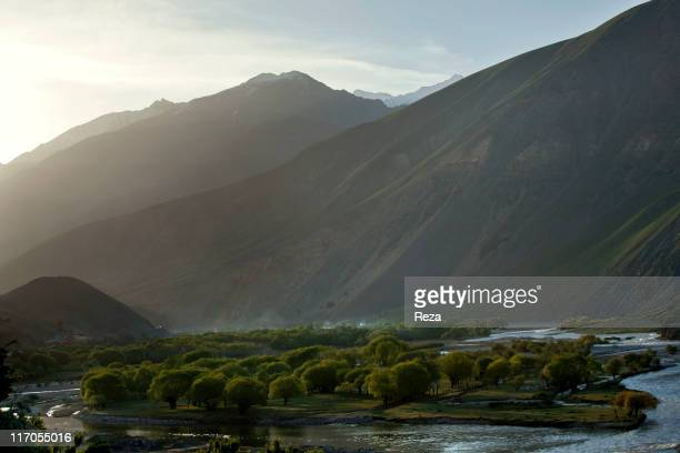 The Panjshir River winding at the foot of the mountains May 13 2009 in Astaneh Afghanistan