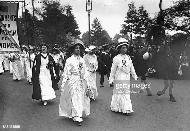 Christabel Emmeline and Sylvia lead a suffragette parade through London 11 June 1911