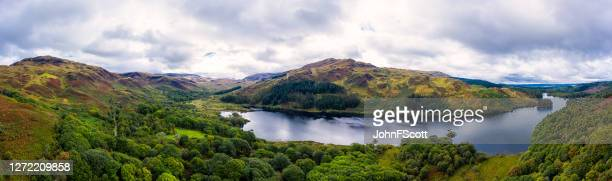 the panoramic aerial view from a drone of a scottish loch and woodland in dumfries and galloway on an overcast day - johnfscott stock pictures, royalty-free photos & images