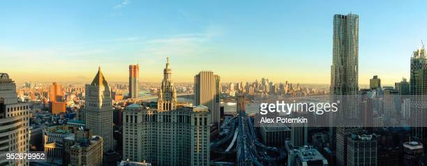 the panoramic scenic view to the manhattan downtown, over the brooklyn bridge and east river toward brooklyn. the skyline includes the major buildings: manhattan municipal building, new york by gehry, thurgood marshall united square courthouse, one brookl - cityscape stock pictures, royalty-free photos & images