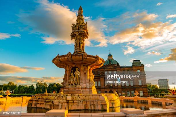 the panoramic view of the famous doulton fountain behind the people's palace museum, golden hour in glasgow green, scotland, united kingdom (uk) - glasgow green stock pictures, royalty-free photos & images