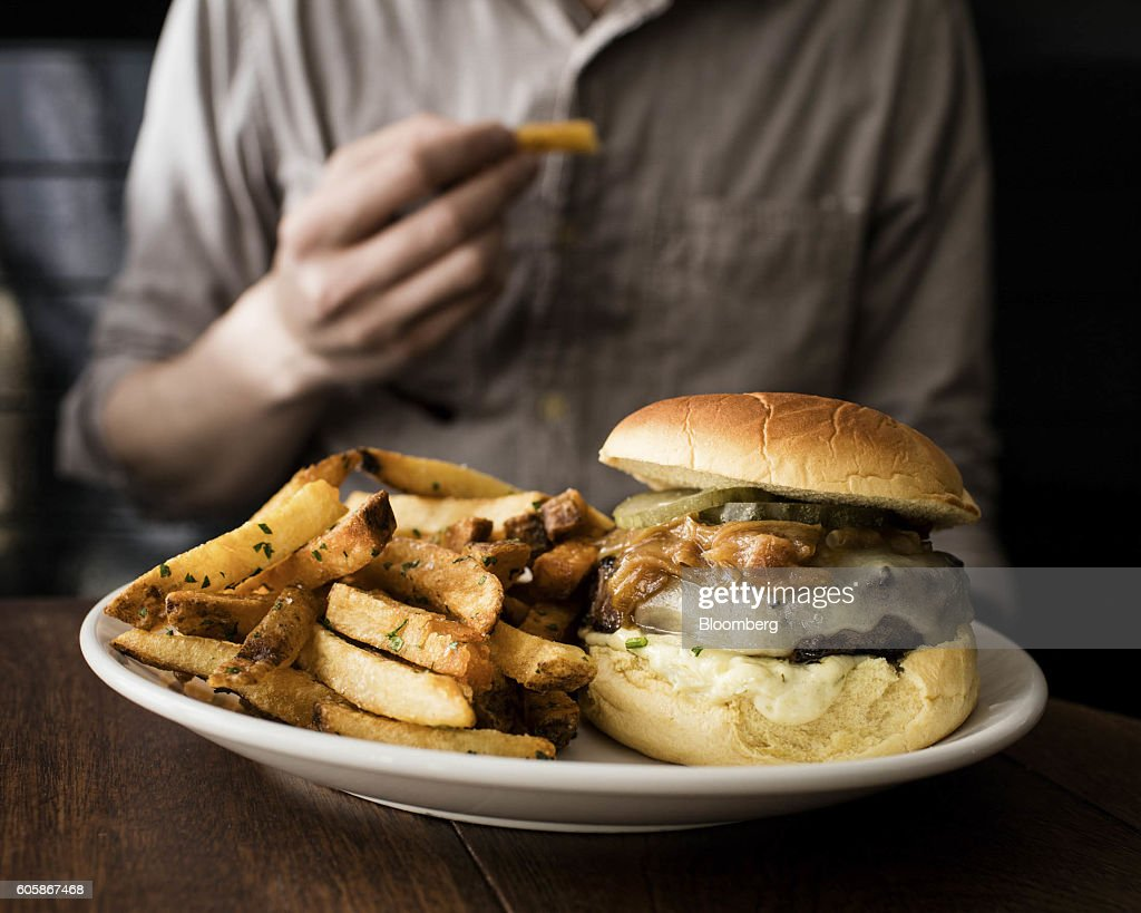 The Pan-Seared Burger with fries sits on a plate at GG's restaurant in New York, U.S., on Tuesday, April 19, 2016. Top chefs pick their all-time favorites, from burgers with fat, mid-rare patties dripping with juice to thin, crisp disks of beef smothered with cheese. These are the ones the true masters crave when they're off duty. Photographer: Eric Medsker/Bloomberg via Getty Images