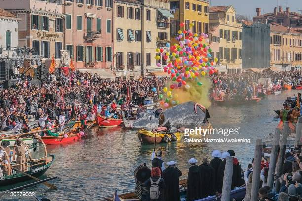 The 'Pantegana' releases balloons and smoke on Canaregio Canal at the end of the traditional regatta for the opening of the 2019 Venice Carnival on...