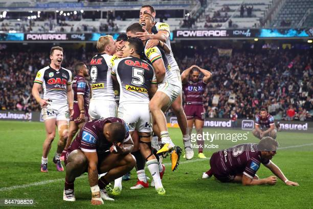 The Panthers celebrate after Bryce Cartwright of the Panthers scored a try during the NRL Elimination Final match between the Manly Sea Eagles and...