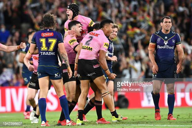 The Panthers celebrate victory during the NRL Preliminary Final match between the Melbourne Storm and the Penrith Panthers at Suncorp Stadium on...