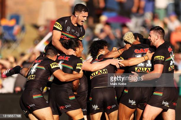 The Panthers celebrate with Stephen Crichton of the Panthers after he scored a try during the round 11 NRL match between the South Sydney Rabbitohs...