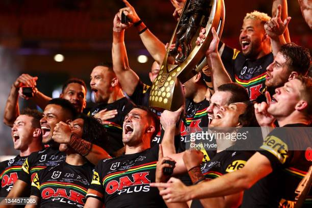 The Panthers celebrate with the NRL Premiership Trophy after victory in the 2021 NRL Grand Final match between the Penrith Panthers and the South...