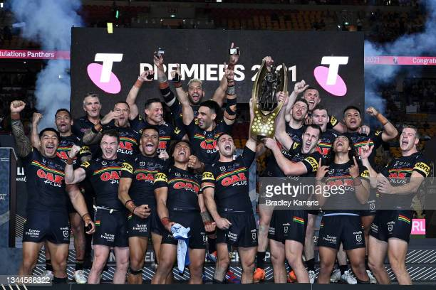 The Panthers celebrate with the Premiership Trophy after winning the 2021 NRL Grand Final match between the Penrith Panthers and the South Sydney...