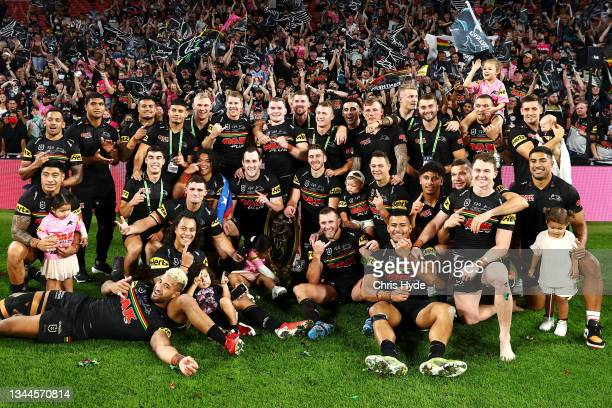 The Panthers pose with the NRL Premiership Trophy after victory in the 2021 NRL Grand Final match between the Penrith Panthers and the South Sydney...