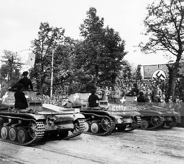 The Panzers German tanks on parade in Poland after the German invasion Hitler salutes as they pass