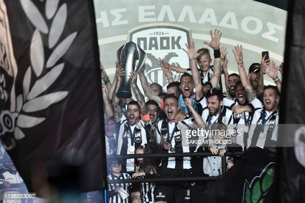 The Paok football team celebrate winning the Greek Super League football title at the Tomba Stadium in Thessaloniki northern Greece on April 21,...