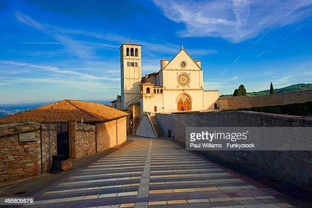 the papal basilica of st francis of assisi, basilica papale di san francesco, assisi, umbria, italy - st. francis of assisi stock photos and pictures