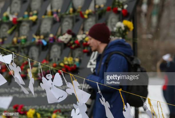 The paper cutted angels are seen hanging near the Heavenly Hundred Memorial downtown Kyiv Ukraine pays tribute to the victims of the 20132014...
