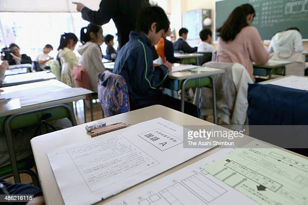 The papers of the national achievement examination is distributed on April 22 2014 in Tokyo Japan 224 million students all the third year junior high...