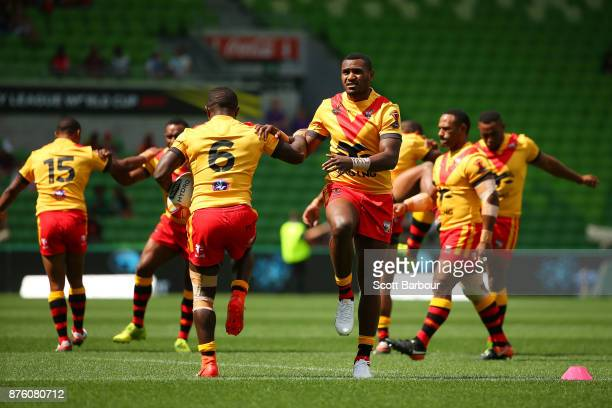 The Papua New Guinea Kumuls warm up during the 2017 Rugby League World Cup Quarter Final match between England and Papua New Guinea Kumuls at AAMI...