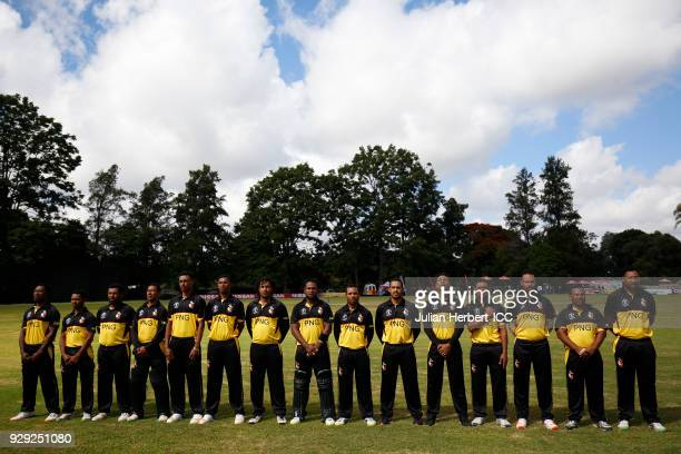 The Papua New Guinea team lines up for the singing of The National Anthems before The Cricket World Cup Qualifier between The West Indies and Papua...