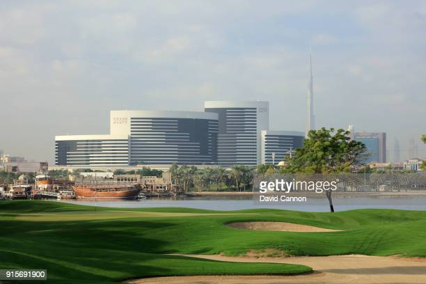The par 3 16th hole with a view across The Dubai Creek to the Hyatt Hotel with the Burj Khalifa in the distance behind at the Dubai Creek Golf Club...