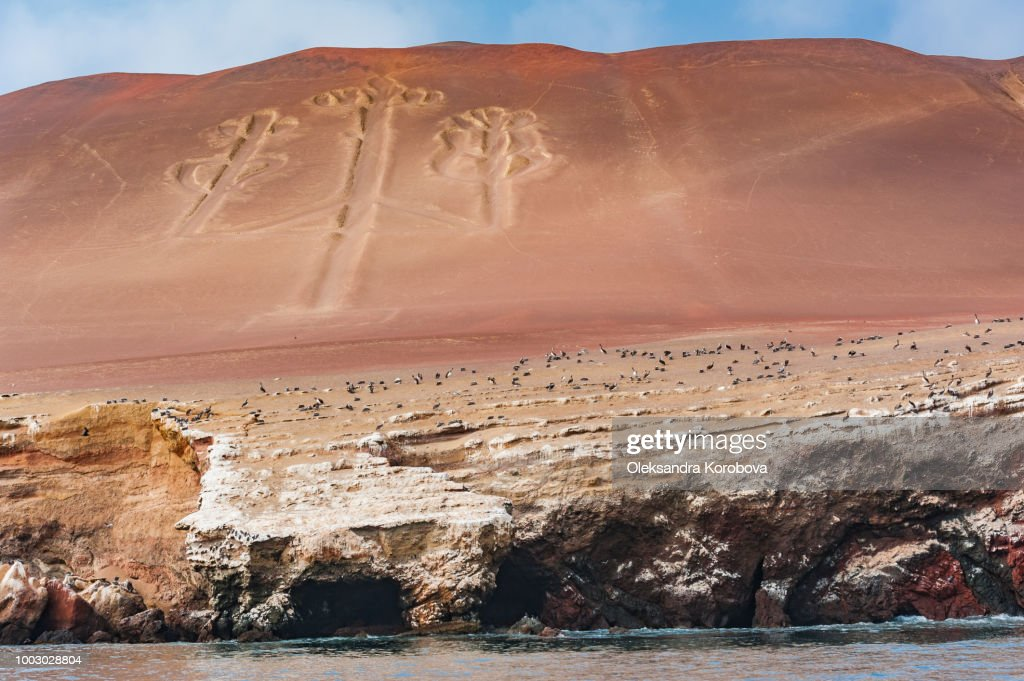The Paracas Candelabra, also called the Candelabra of the Andes, is a prehistoric geoglyph found on the northern face of the Paracas Peninsula at Pisco Bay in Peru, carved into the red cliffs. : Stock Photo