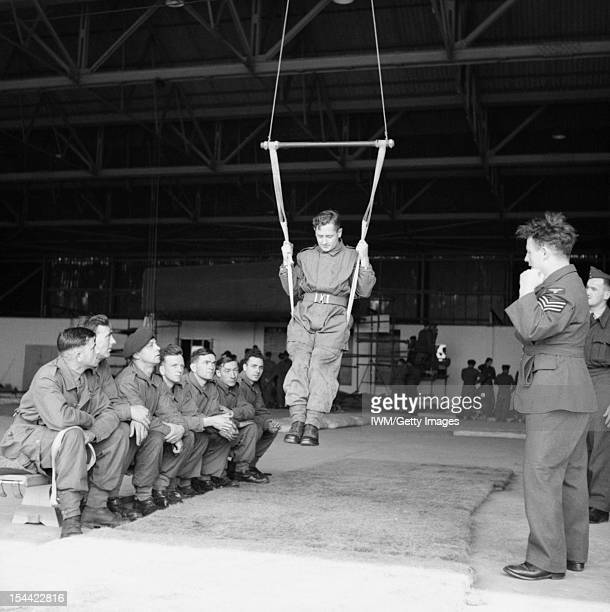 The Parachute Regiment In Training August 1942 Inside a hangar a paratrooper learns to land correctly using a special harness