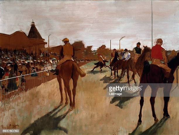 The parade also known as Race horses in front of the tribunes Painting by Edgar Degas 18661868 Oil on paper mounted on canvas Dim 046 x 061 m Paris...