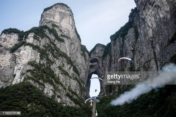 The paraglider rides the paramotor during Heavens Gate Paramotor Air Games on June 262019 in Zhang JiajieHunan ProvinceChina