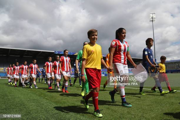 The Paraguay and Japan players walk out prior to the FIFA U20 Women's World Cup France 2018 group C match between Japan and Paraguay at Stade de la...