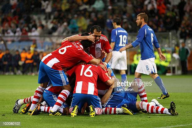 The Paraguay players celebrate as Antolin Alcaraz of Paraguay scores the opening goal during the 2010 FIFA World Cup South Africa Group F match...