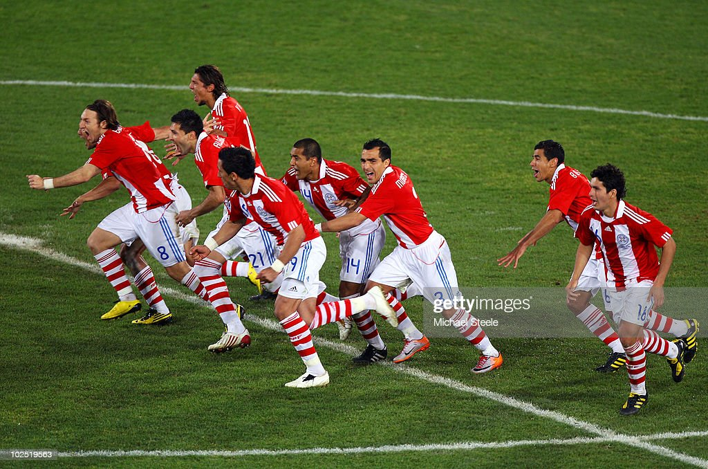 The Paraguay team celebrate the penalty of Oscar Cardozo as they win a penalty shoot-out during the 2010 FIFA World Cup South Africa Round of Sixteen match between Paraguay and Japan at Loftus Versfeld Stadium on June 29, 2010 in Pretoria, South Africa.