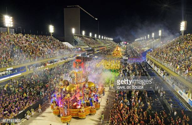 TOPSHOT The Paraiso do Tuiuti samba school performs during the first night of Rio's Carnival at the Sambadrome in Rio de Janeiro Brazil on February...