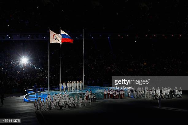 The Paralympic flag and Russian flag are raised side by side during the Closing Ceremony of the 2014 Paralympic Winter Games at Fisht Olympic Stadium...
