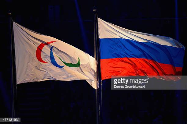 The Paralympic flag flies next to the Russia flag during the Opening Ceremony of the Sochi 2014 Paralympic Winter Games at Fisht Olympic Stadium on...