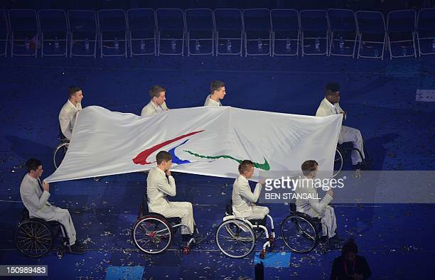 The Paralympic Flag is carried to be raised during the opening ceremony of the London 2012 Paralympic Games at the Olympic Stadium in east London on...