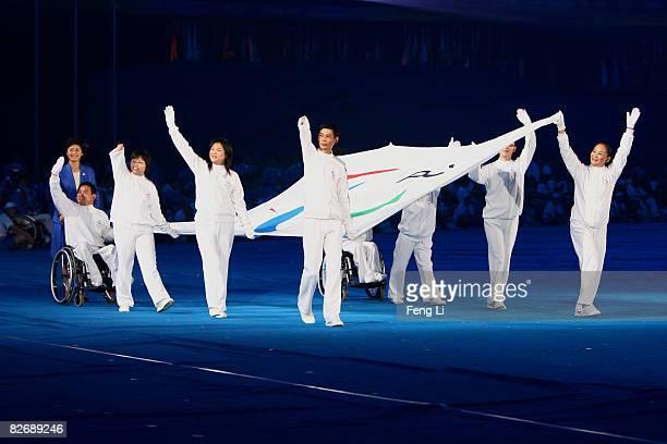 The Paralympic flagbearers Bian Jianxin Wang Jian Wu Yancong Zhao Jihong Huang Wentao Chen Weihong Wang Yanhong and Wu Hongping carry the Paralympic...