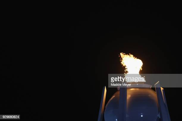 The Paralympic flame is seen during the opening ceremony of the PyeongChang 2018 Paralympic Games at the PyeongChang Olympic Stadium on March 9 2018...
