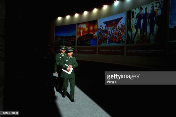 """The paramilitary policemen visit an exhibition entitled """"Scientific Development and Splendid Achievements"""" before the18th National Congress of the..."""