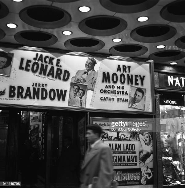The Paramount Theatre entrance reads Jack E Leonard 'World's Largest Comedian' Jerry Brandow Ar Mooney and Orchestra featuring Cathy Ryan in November...