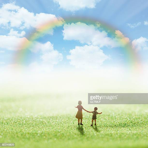 The parent and child is under the rainbow.