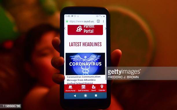 The Parent Portal information on coronavirus from the Alhambra Unified School District is displayed on a cellphone on February 4, 2020 in Alhambra,...