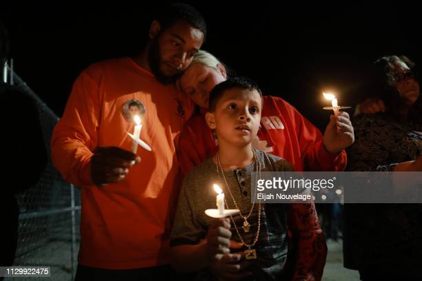 The parents and brother of Armando Hernandez the youngest victim of the deadly tornado that struck the town last week participate in a candlelight...