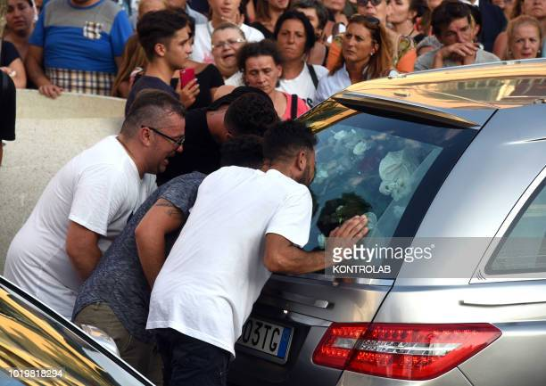 The parents behind the car with the coffin of their son after the funeral of Giovanni Battiloro Matteo Bertonati Gerardo Esposito and Antonio...