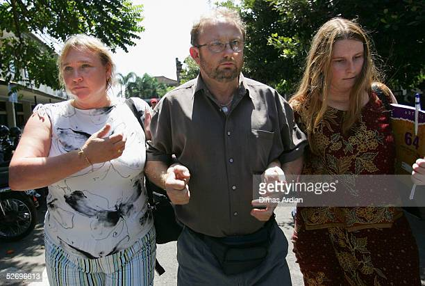 The parents of 29yearold Australian Martin Stephens are seen holding hands on April 26 2005 in Denpasar Bali Indonesia Stephens was arrested at...